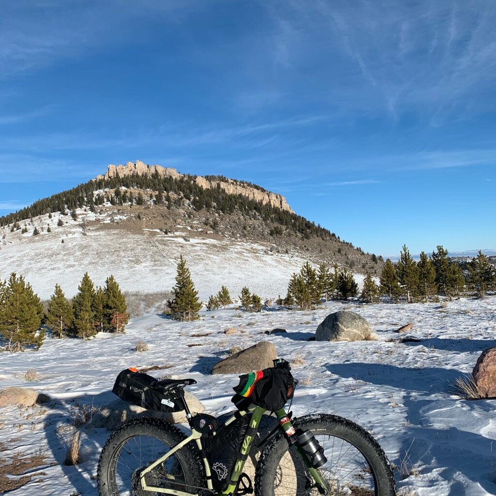 Winter cycling and fat biking in Wyoming with bar mitts or pogies.