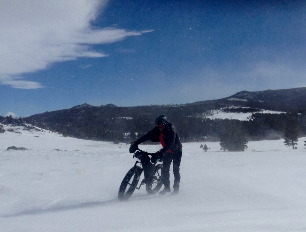 Ground blizzard while fat biking in the Wind River Mountains, Wyoming.