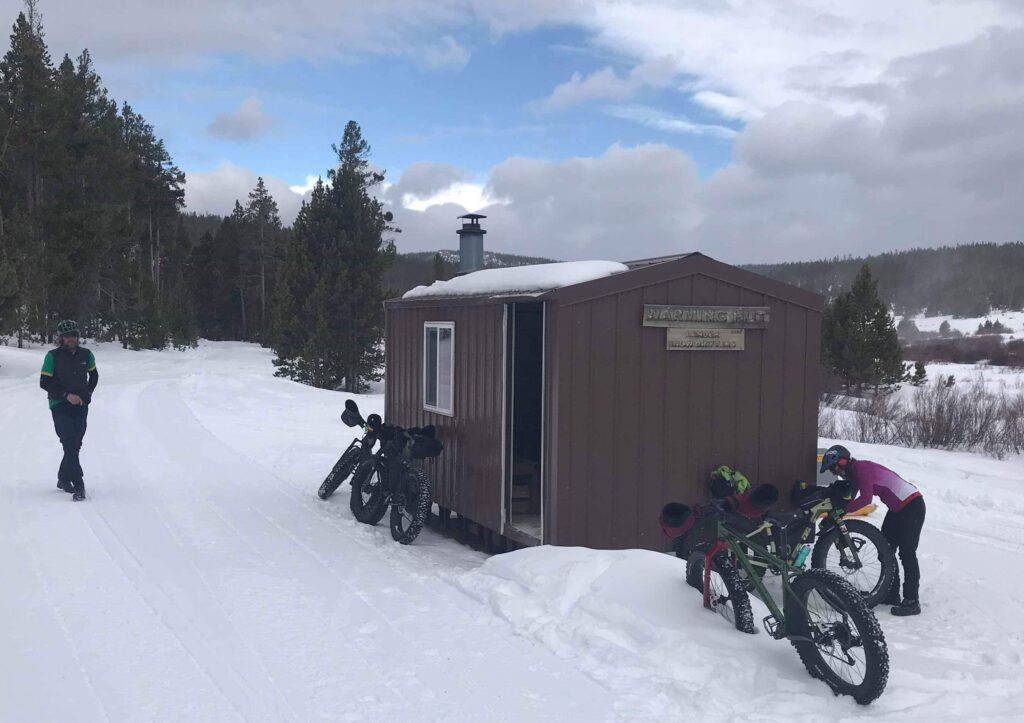Winter fat biking in the Wind River Mountains near Lander, Wyoming and South Pass, Wyoming and the warming hut on the Loop Road