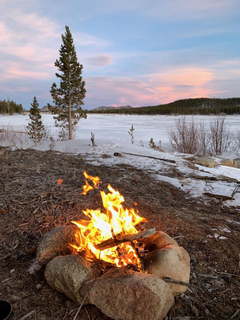 Winter bikepacking by fat bike in the Wind River Mountains of Wyoming.  Sunset at Worthen Reservoir.